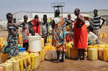 FILE - Residents of a camp for the internally-displaced line up to get water from a borehole, on the outskirts of the capital Juba, South Sudan, Jan. 22, 2019.