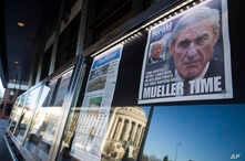 Newspaper front pages from around the nation are on display at the Newseum, March 23, 2019, in Washington. Special counsel Robert Mueller closed his Russia investigation with no new charges, ending the probe that has cast a shadow over Donald Trump's
