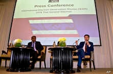 Rohana Nishanta Hettiarachchie, left,  secretary general of The Asian Network for Free Elections (ANFREL) watches as Amael Vier, program officer for Capacity Building, right, speaks during a press conference concluding their election monitoring in Ba