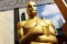 FILE - An Oscar statue appears outside the Dolby Theatre for the Academy Awards in Los Angeles, Feb. 21, 2015.