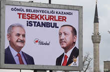 A poster displayed in Istanbul thanks voters for a victory in a premature celebration by Turkish President Recep Tayyip Erdogan's AKP party.