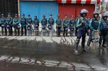 FILE - Bangladeshi policemen stand guard on a road near a court during a verdict against opposition leader and former Prime Minister Khaleda Zia in Dhaka, Bangladesh, Feb. 8, 2018.