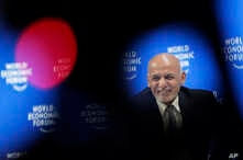Afghanistan's President Ashraf Ghani smiles during a session at the annual meeting of the World Economic Forum in Davos, Switzerland, Thursday, Jan. 24, 2019.
