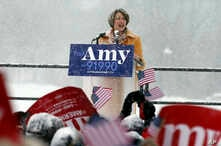 Democratic Sen. Amy Klobuchar, left, addresses a snowy rally where she announced she is entering the race for president, Feb. 10, 2019, at Boom Island Park in Minneapolis.