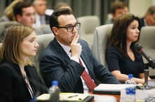 FILE - From left, Katelyn Love, Josh Lawson and Kim Strach, executive director of the Board of Elections, listen during a public evidentiary hearing on the 9th Congressional District investigation at the North Carolina State Bar in Raleigh, N.C., Feb