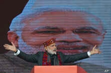 FILE - Indian Prime Minister Narendra Modi addresses a political gathering of his Bharatiya Janata Party, in Himachal Pradesh, in Dharmsala, India, Dec. 27, 2018.