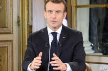 French President Emmanuel Macron speaks during a special address to the nation, his first public comments after four weeks of nationwide 'yellow vest' (gilet jaune) protests, Dec. 10, 2018, at the Elysee Palace, in Paris.