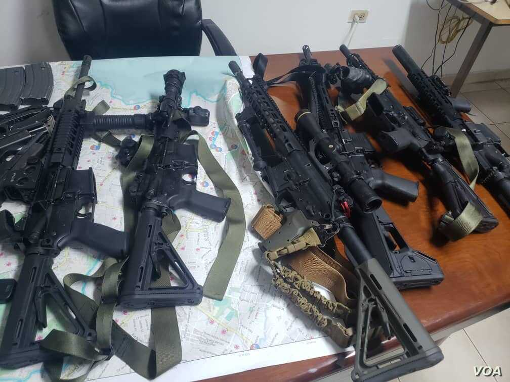 """Some of the weapons seized by Haiti's national police force officers (PNH) Sunday after arresting 8 men who are charged with """"conspiracy""""."""