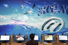 FILE - An Iranian man surfs the Internet at a cafe in Tehran, Iran, Sept, 17, 2013.