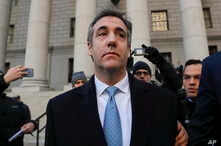 """Michael Cohen walks out of federal court Nov. 29, 2018, in New York, after pleading guilty to lying to Congress about work he did on an aborted project to build a Trump Tower in Russia. Cohen said he lied to be consistent with President Trump's """"poli"""