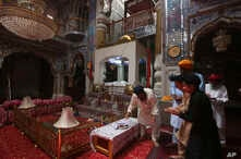 People from Pakistan Sikh community visit their temple in Peshawar, Pakistan, Aug. 8, 2017. Today Sikhs are battling with the Pakistan government for ownership of dozens of Sikh temples that they call gurdwaras and while it is slow going they have ma