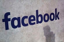FILE -  A Facebook logo is displayed at a start-up companies' gathering at Paris' Station F, in Paris, France, Jan. 17, 2017.