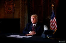 U.S. President Donald Trump takes questions from the media after speaking via teleconference with troops from Mar-a-Lago estate in Palm Beach, Florida,  Nov. 22, 2018.