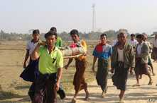 FILE - Residents carry the body of an ethnic Rakhine woman for burial in Rathedaung township, after fresh fighting in Rakhine state between the Myanmar military and the Arakan Army, an ethnic Rakhine force, Feb. 21, 2019.