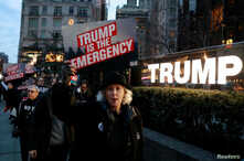 People gather to protest U.S. President Donald Trump's declaration of a national emergency to build a border wall, at Trump International Hotel & Tower in New York, Feb. 15, 2019.