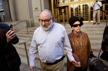 Convicted spy Jonathan Pollard and his wife, Esther, leave the federal courthouse in New York, Nov. 20, 2015. Within hours of his release, Pollard's attorneys began a court challenge to terms of his parole. He served 30 years for selling intelligence