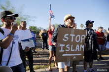 """FILE - Demonstrators shout during a """"Freedom of Speech Rally Round II"""" outside the Islamic Community Center in Phoenix, Arizona May 29, 2015."""