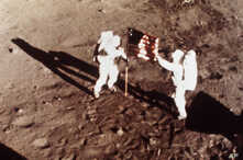 """** FILE ** In this July 20, 1969 file photo, Apollo 11 astronauts Neil Armstrong and Edwin E. """"Buzz"""" Aldrin, the first men to land on the moon, plant the U.S. flag on the lunar surface. (NASA)"""