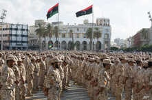 Military units under the Tripoli government stand in formation during a celebration of the 75th anniversary of the establishment of the Libyan Army in Martyrs Square, Tripoli, Libya, Aug. 13, 2015.