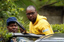 FILE - Activist Pastor Evan Mawarire is taken into a vehicle by police outside his home in Harare, Zimbabwe, Jan. 16, 2019.