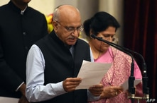 Bharatiya Janata Party (BJP) politician M.J. Akbar takes the oath during the swearing-in ceremony of new ministers, July 5, 2017, following Prime Minister Narendra Modi's cabinet re-shuffle at the Presidential Palace in New Delhi.