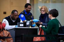 Transportation Security Administration workers screen airline passengers at Reagan Washington National Airport in Washington, Jan. 28, 2019, as federal workers and government contract workers return to work ending the record 35-day partial federal sh