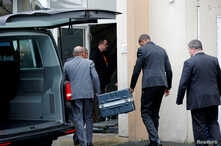 Men unload a case from a diplomatic car from the Ethiopian Embassy outside the headquarters of France's BEA air accident investigation agency in Le Bourget, north of Paris, France, March 14, 2019. The black boxes from the crashed Ethiopian Airlines B...