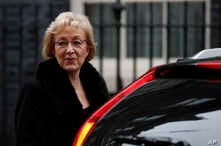 FILE - Andrea Leadsom, leader of the House of Commons, leaves after attending a cabinet meeting at 10 Downing Street, in London, Dec. 18, 2018.