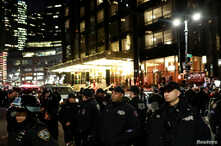 Police gather on the street during a protest against U.S. President Donald Trump's declaration of a national emergency to build a border wall, outside Trump International Hotel & Tower in Manhattan, New York, U.S. Feb. 15, 2019.