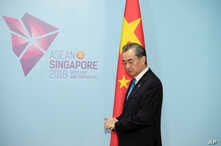China's Foreign Minister Wang Yi pauses before a bilateral meeting with Philippines' Foreign Affairs Secretary Alan Cayetano on the sidelines of the 51st ASEAN Foreign Ministers Meeting in Singapore, Aug. 2, 2018.