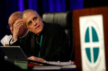 Cardinal Daniel DiNardo of the Archdiocese of Galveston-Houston, president of the United States Conference of Catholic Bishops, prepares to lead the USCCB's annual fall meeting, Nov. 12, 2018, in Baltimore, Maryland.