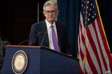 Federal Reserve Chairman Jerome Powell arrives to speak at a news conference, Wednesday, Jan. 30, 2019, in Washington.