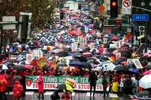 Thousands of teachers and supporters hold signs in the rain during a rally, Jan. 14, 2019, in Los Angeles. Tens of thousands of Los Angeles teachers went on strike Monday for the first time in three decades after contract negotiations failed in the n