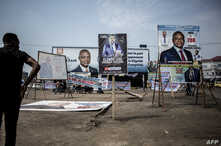 A man looks at campaign posters in the district of Lingwala in Kinshasa, DRC, Dec. 18, 2018.