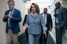 House Speaker Nancy Pelosi, D-California, walks to a Democratic Caucus meeting at the Capitol in Washington, Tuesday, March 26, 2019. Pelosi and leading House Democrats are unveiling broad legislation today to shore up the Affordable Care Act.