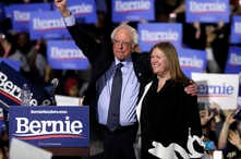 Sen. Bernie Sanders, I-Vt. (L) and his wife, Jane O'Meara Sanders, greet supporters as they leave after his 2020 presidential campaign stop at Navy Pier in Chicago, March 3, 2019.