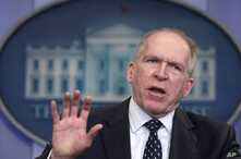 FILE - Deputy National Security Adviser for Homeland Security and Counterterrorism John Brennan gestures during the daily news briefing at the White House in Washington, May 2, 2011.