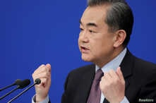 Chinese Foreign Minister Wang Yi attends a news conference on the sidelines of the National People's Congress, China's parliamentary body, in Beijing, March 8, 2019.