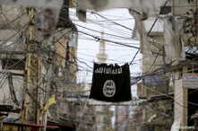 An Islamic State flag hangs amid electric wires over a street in Ain al-Hilweh Palestinian refugee camp, near the port-city of Sidon, southern Lebanon January 19, 2016. REUTERS/Ali Hashisho - GF20000099887