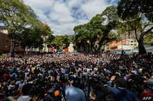 "A crowd of opposition supporters gather to listen to Venezuela's National Assembly head and the country's self-proclaimed ""acting president"" Juan Guaido, at Bolivar Square in Chacao, eastern Caracas, on Jan. 25, 2019."