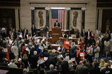 In this image from video provided by House Television, House Speaker Paul Ryan stands at the podium as he brings the House into session Wednesday night, June 22, 2016, in Washington.