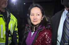FILE -  Huawei Technologies Chief Financial Officer Meng Wanzhou as she exits the court registry following the bail hearing at British Columbia Superior Courts in Vancouver, British Columbia on Dec. 11, 2018.