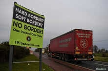 """FILE - A sign for """"No border"""" is seen on the border between Northern Ireland and Ireland in Jonesborough, Northern Ireland, Dec. 10, 2018."""