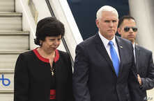 US Vice President Mike Pence is welcomed by Colombia's Foreign Affairs Vice Minister Luz Stella Jara upon arrival in Bogota, on Feb. 25, 2019.