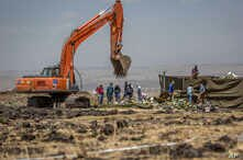 Investigators continue recovery work at the scene where the Ethiopian Airlines Boeing 737 Max 8 crashed shortly after takeoff on Sunday killing all 157 on board, near Bishoftu, south-east of Addis Ababa, Ethiopia, March 15, 2019.