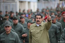 Venezuela's President Nicolas Maduro gestures during a meeting with soldiers at a military base in Caracas, Venezuela, Jan. 30, 2019.