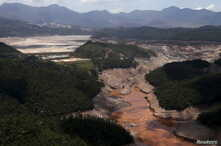 General view from above of a dam owned by Vale SA and BHP Billiton Ltd. that burst, in Mariana, Brazil, Nov. 10, 2015.