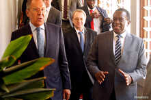 Zimbabwean President Emmerson Mnangagwa walks with Russian Foreign Minister Sergey Lavrov before their meeting in Harare, Zimbabwe, March 8, 2018.