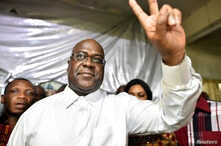 FILE - Felix Tshisekedi, leader of the Congolese main opposition party, was announced as the winner of the presidential elections. He gestures to his supporters at the party headquarters in Kinshasa, Democratic Republic of Congo, Jan. 10, 2019.