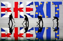 Small toy figures are seen in front of a Brexit logo in this illustration picture, March 30, 2019.